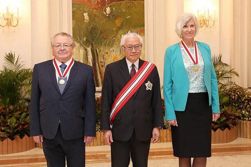 President Tony Tan Keng Yam with this year's recipients of the Honorary Citizen Award: Sir George Radda (left) and Dr Joan Rose. Prof Radda, 79, was recognised for playing a pivotal role in Singapore's biomedical sciences industry, while Dr Rose, 61,