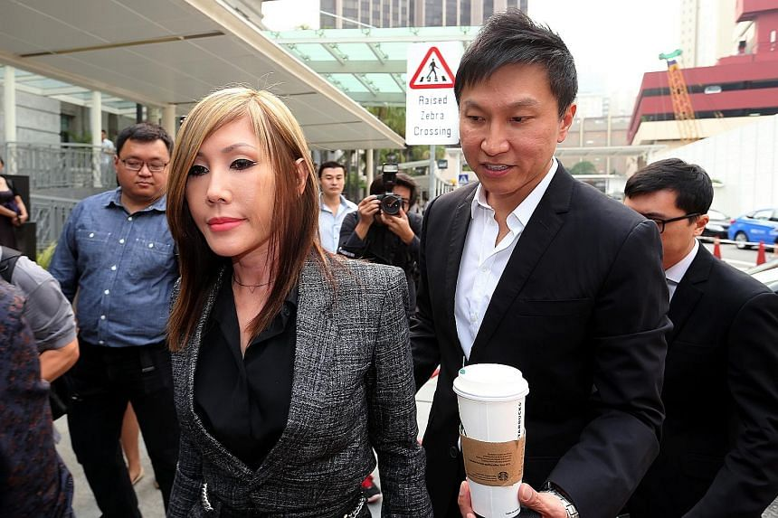 CHC founder Kong Hee and his wife Ho Yeow Sun arriving at the courts yesterday.