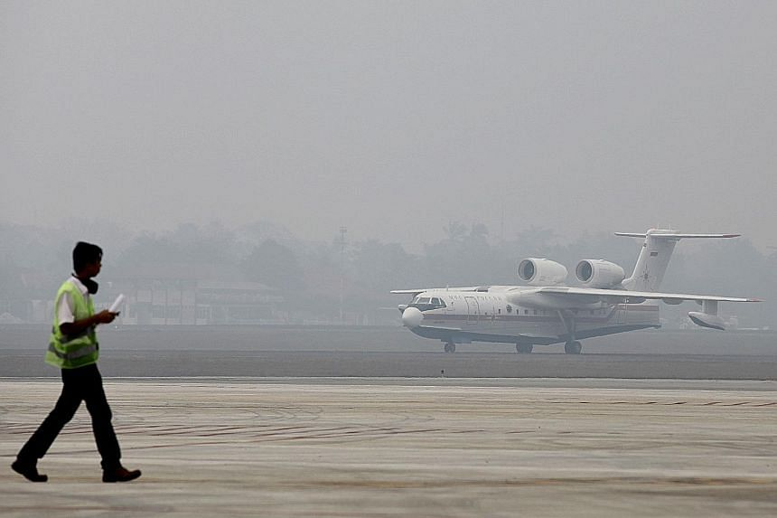 A Russian-made Beriev Be-200 amphibious firefighting aircraft arriving at an airbase in Palembang, South Sumatra province, yesterday. Indonesia has said it needs more water-bombing aircraft to fight its fires.
