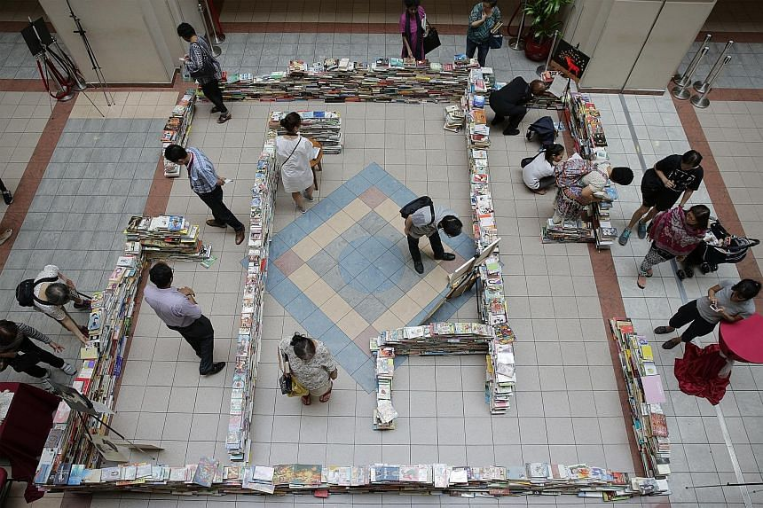 Visitors are drawn to Tan Tock Seng Hospital's art installation, A Book Maze (above), which is made up of 3,500 books of different genres. It is part of the hospital's Art of Healing programme that aims to use the arts to help patients relax. The boo