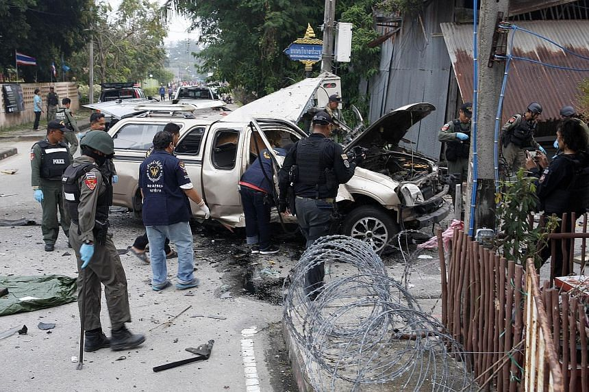 Members of a bomb squad inspecting the scene on Tuesday following a blast set off by suspected separatist militants in Thailand's restive southern province of Narathiwat. More than 6,400 people have been killed since 2004 in a simmering conflict pitt