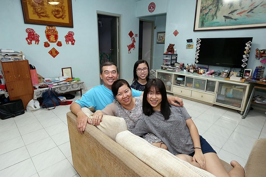 Mr Liew Cheng Liang, 54, with his wife, Jojo Oo, 52, and two of their three daughters, Chloe (foreground), 21, and Evon, 13. Thanks to the HDB's relaxed rule allowing sellers to negotiate for a temporary extension of stay, the family can stay on in t