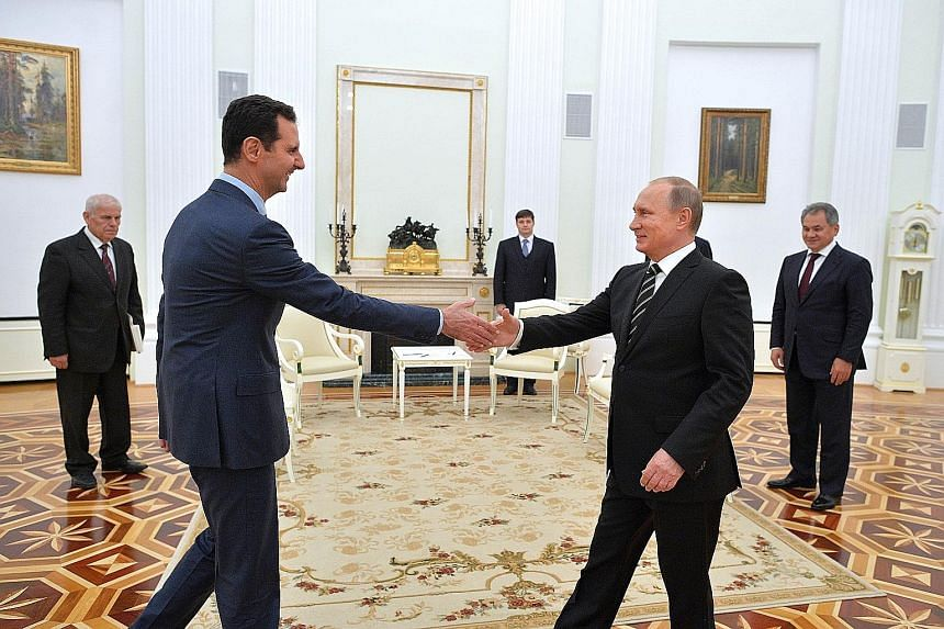 Russian President Vladimir Putin (right) welcoming his Syrian counterpart, Mr Bashar al-Assad, to the Kremlin on Tuesday. It was Mr Assad's first foreign trip since war broke out in Syria.