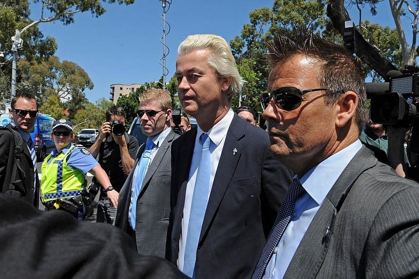 Mr Geert Wilders (centre) leaving Parliament House in Perth yesterday after a press conference.