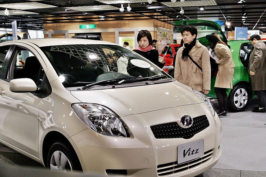 A Toyota compact car, the Vitz, which is exported under the name Yaris. This model is among several that the Japanese auto giant is recalling worldwide over a power window glitch.