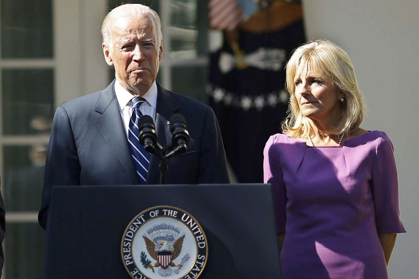 Mr Biden announcing the news with wife Jill at his side.