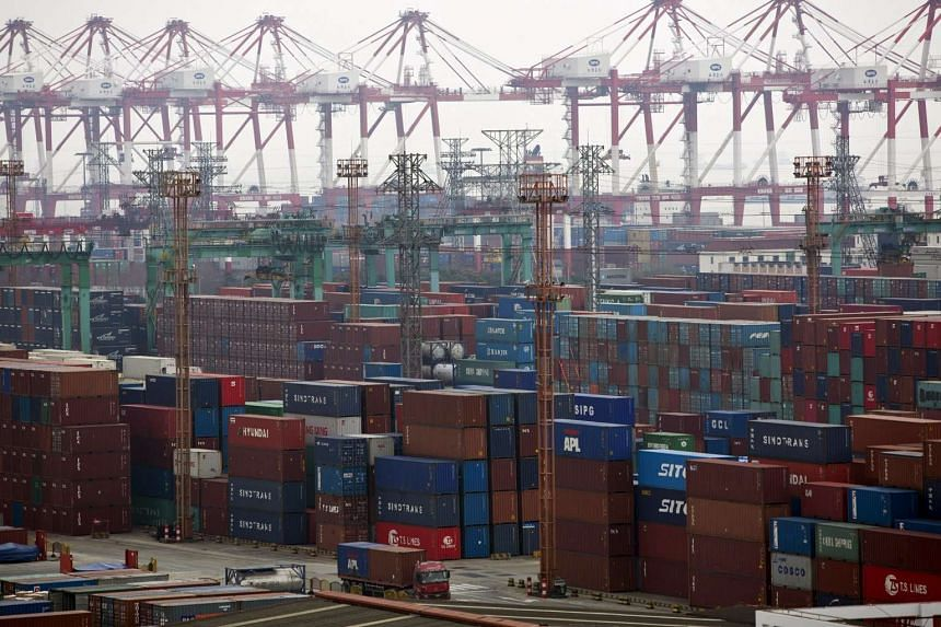 Containers seen at a port of Shanghai Free Trade Zone, in this Feb 11, 2014, file photo.