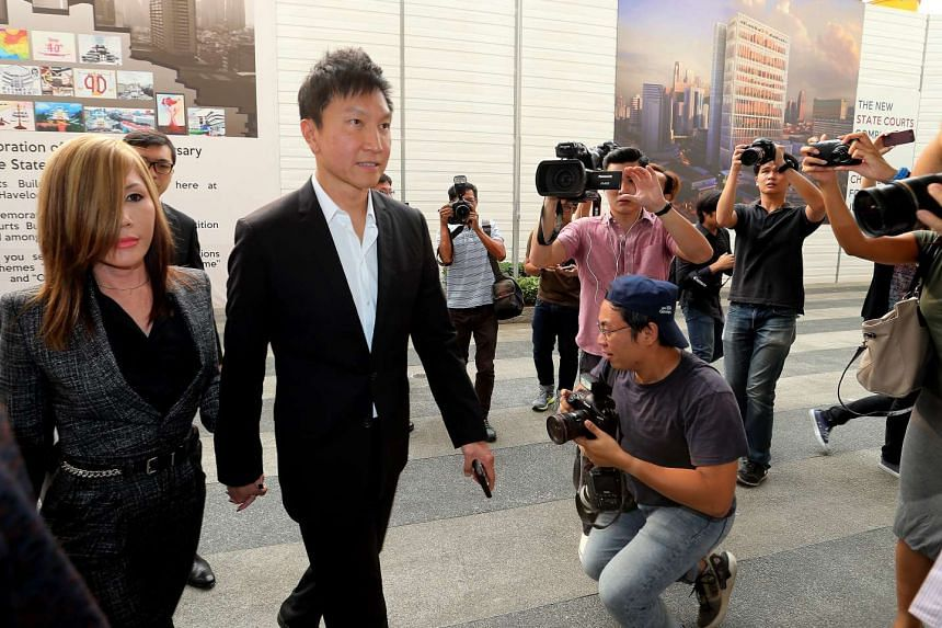 City Harvest church founder, Kong Hee and his wife Ho Yeow Sun (left) arriving at the state courts on Oct 21, 2015.