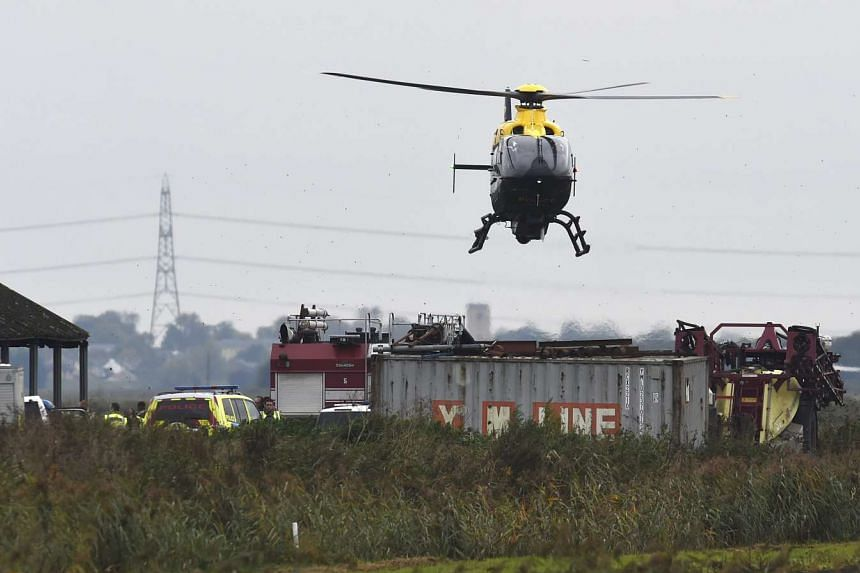 A police helicopter hovers over the scene of the crash.