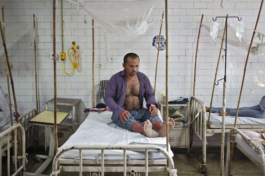 A patient awaits a routine check-up in the dengue ward of a government hospital in New Delhi.