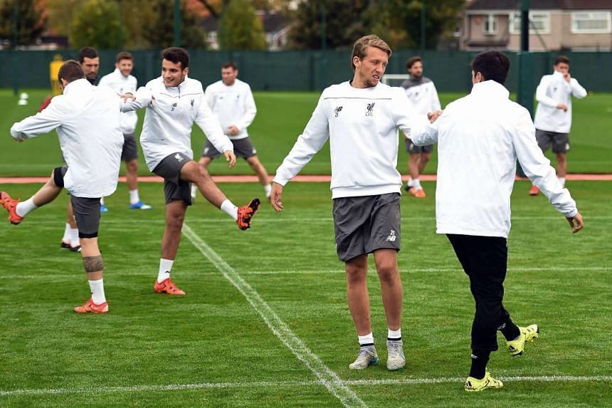 Liverpool's Brazilian midfielder Lucas Leiva (second, right) stretching during a team training session on Oct 21, 2015.