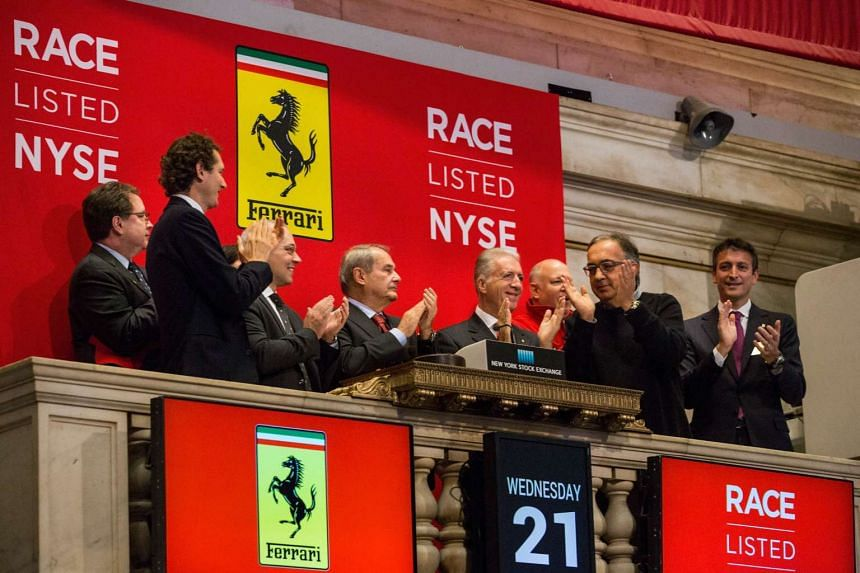 Executives from Fiat Chrsyler Automobiles and Ferrari Automotive, including Piero Ferrari and Sergio Marchionne, ringing the opening bell of the New York Stock Exchange on Oct 21, 2015.