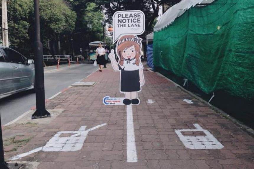 """Thailand's first """"mobile phone lane"""" for pedestrians has been implemented at Bangkok's Kasetsart University to accommodate tardy students who are sick of bumping into smartphone users on their way to class."""