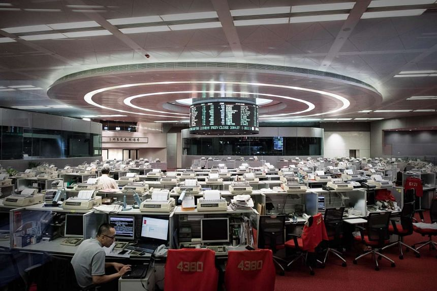 Traders on on the floor of the Hong Kong Stock Exchange on Aug 12, 2015.