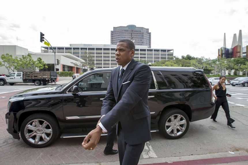 Rapper Jay Z arrives at a US District Court in Los Angeles to testify on Oct 14, 2015 in a copyright lawsuit over his hip-hop classic song Big Pimpin'.