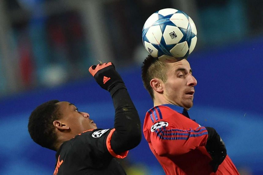 Manchester United's French forward Anthony Martial (left) vies for the ball with CSKA Moscow's Serbian midfielder Zoran Tosic.