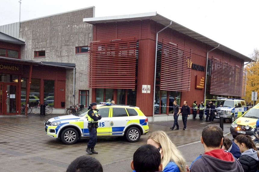 Swedish police blocking off the area after a masked man attacked people with a sword at the Kronan school in Trollhaettan in western Sweden on Oct 22, 2015.