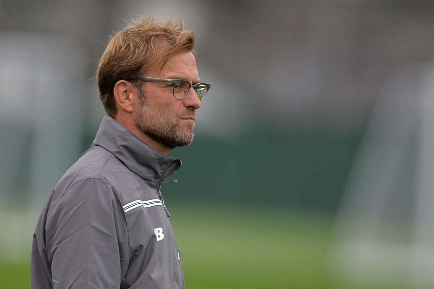New Liverpool manager Juergen Klopp has criticised the demands placed on young players in England.