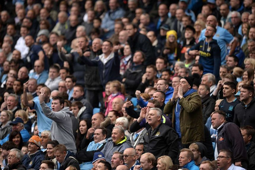 Manchester City fans gesture at the officials during the English Premier League football match between Manchester City and Newcastle United on Oct 3.