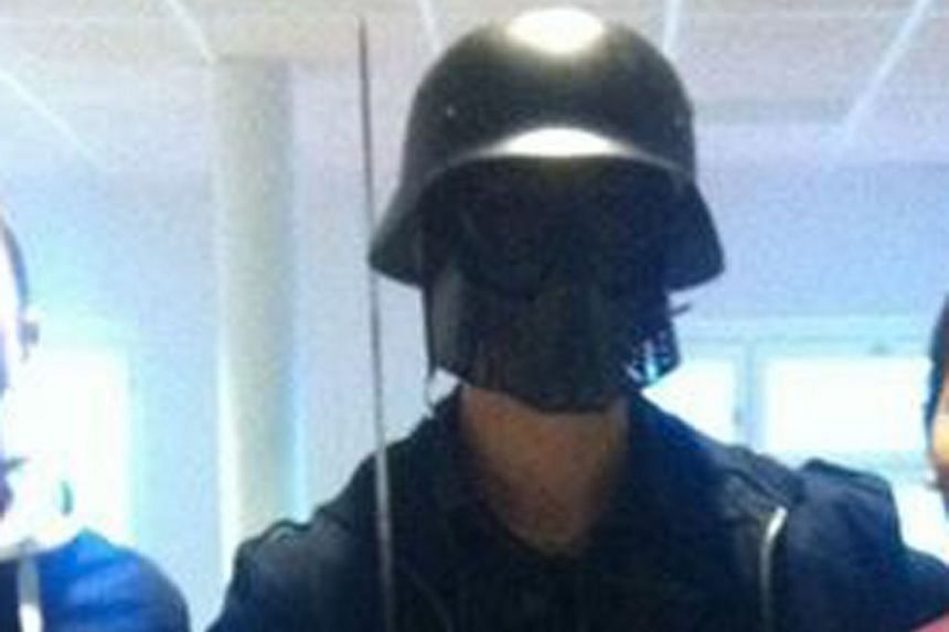 A photo made available by a student shows the masked man armed with a sword posing for a photo before his attack at the primary and middle school in Trollhattan, Sweden, on Oct 22, 2015.