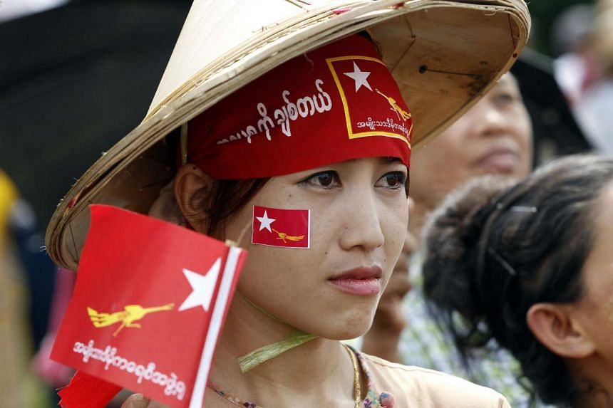 An opposition supporter attends the NLD party campaign in HmaBi township, on the outskirts of Yangon.