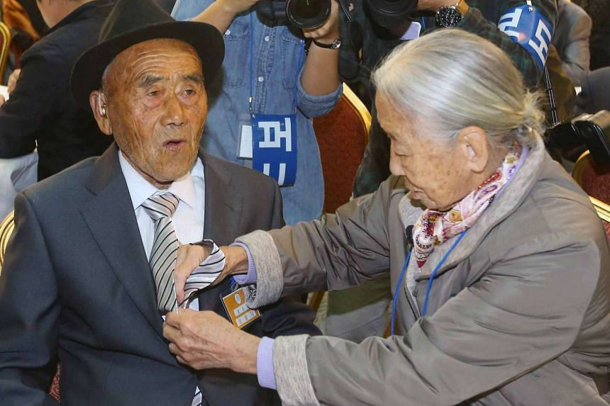 South Korean Lee Sun-gyu (right), 85, with her North Korean husband Oh In Se, 83, at a reunion for separated families at Mount Kumgang resort in North Korea on Oct 22, 2015.