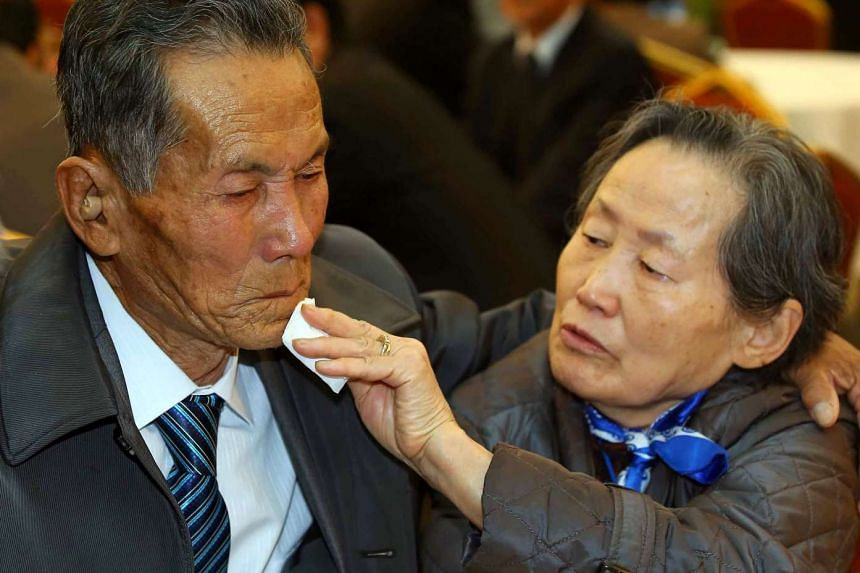 South Korean Son Gwon-Bun (right), 78, bidding farewell to her North Korean brother Son Gwon-Geun (left), 83, after a family reunion at the Mount Kumgang resort in the North on Oct 22, 2015.