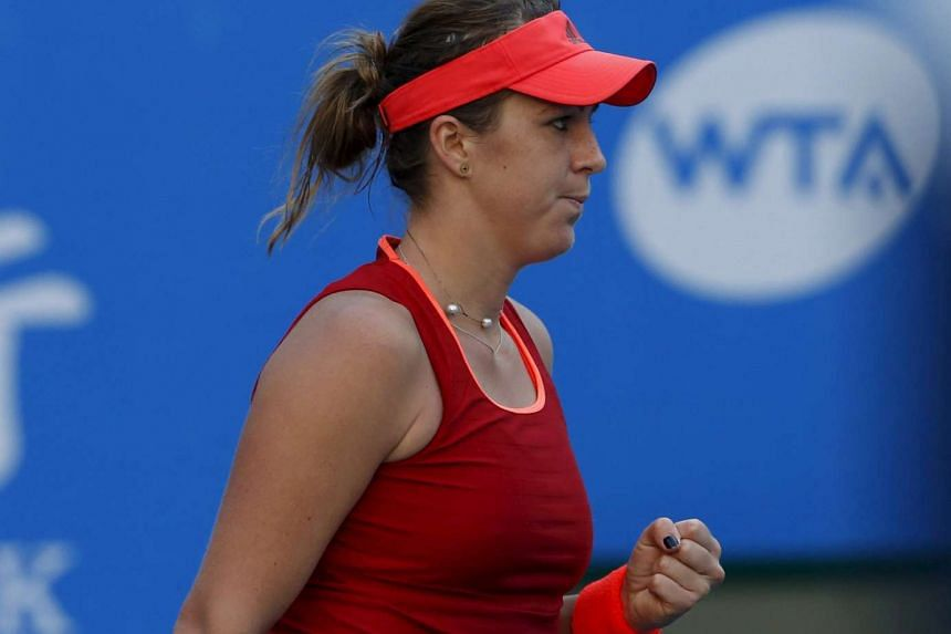 Anastasia Pavlyuchenkova of Russia reacts after winning a point against Italy's Flavia Pennetta.