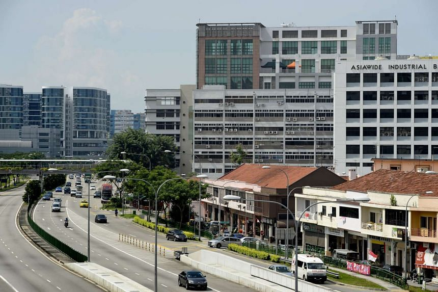 Industrial buildings and shophouses (right) along Upper Paya Lebar Road.