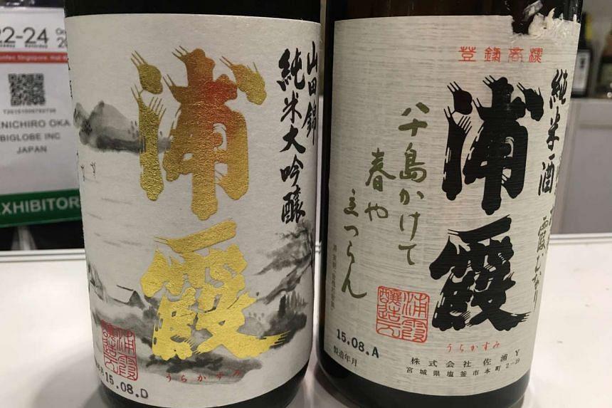 Bottles of Urakasumi Jyunmai Daiginjyo (left) and Urakasumi Jyunmai sake at the Oishii Japan food and beverage trade fair at Suntec City.