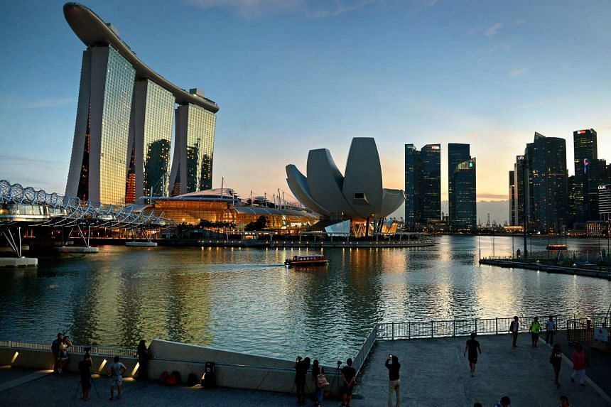 Singapore's Marina Bay with Marina Bay Sands (left) and its ArtScience Museum (centre) in the background.