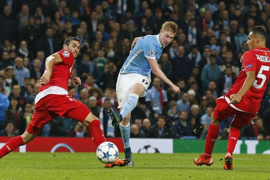 Manchester City's Kevin De Bruyne scores their second goal during the Uefa Champions League Group Stage football match between Manchester City and Sevilla.