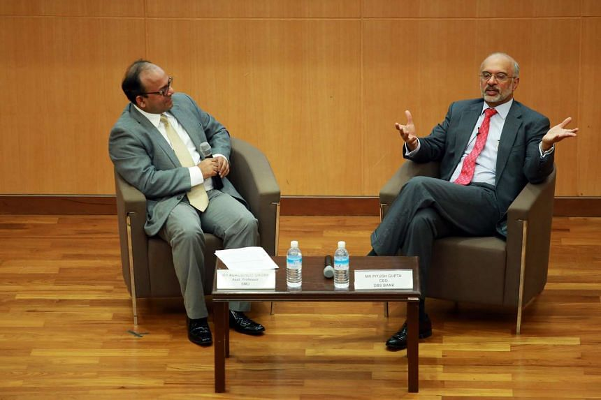 SMU Assistant Professor Aurobindo Ghosh (left) and DBS chief Piyush Gupta at the My Money @ Campus Seminar yesterday. Mr Gupta told SMU students that if they focus on a few macro trends and the fundamentals, their portfolios are likely to prosper ove