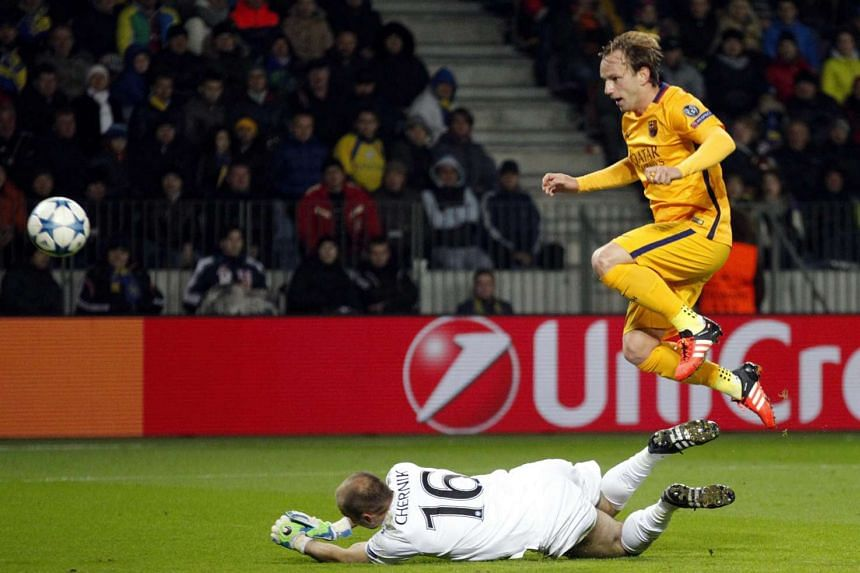 Barcelona's Ivan Rakitic (right) is airborne while scoring against Sergey Chernik of Bate Borisov during the Uefa Champions League qualifying match in Borisov, Belarus on Tuesday.