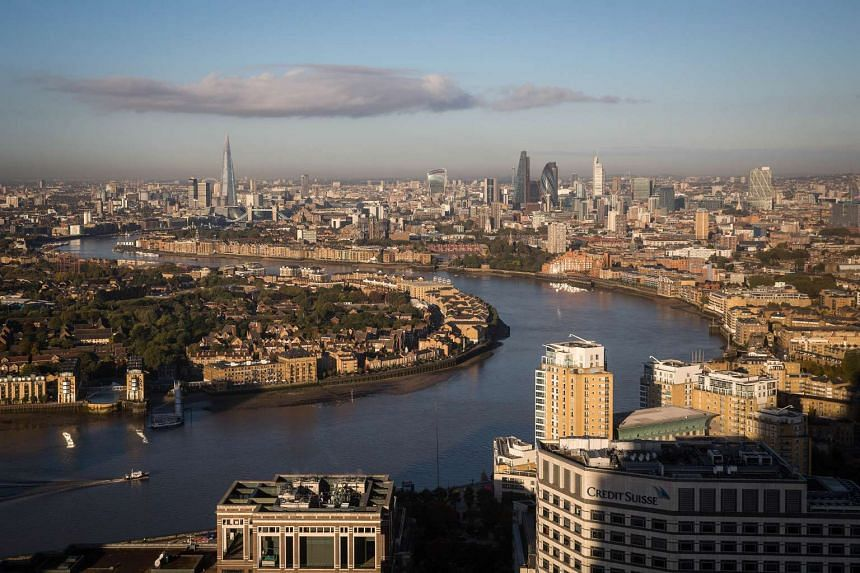 The River Thames flows through London, UK, on Oct 14, 2015.