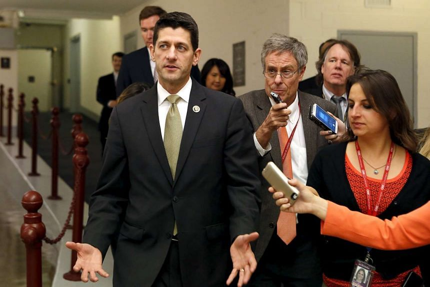 US Representative Paul Ryan (left) speaking to reporters after the House Freedom Caucus meeting in Washington on Oct 21, 2015.
