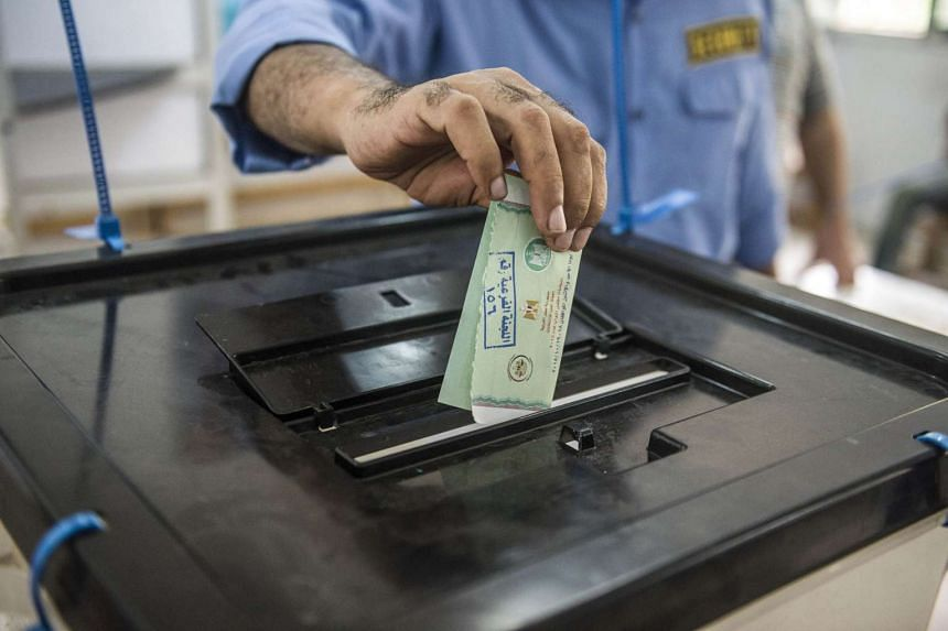 An Egyptian man casts his ballot at a polling station in Cairo's Giza district.