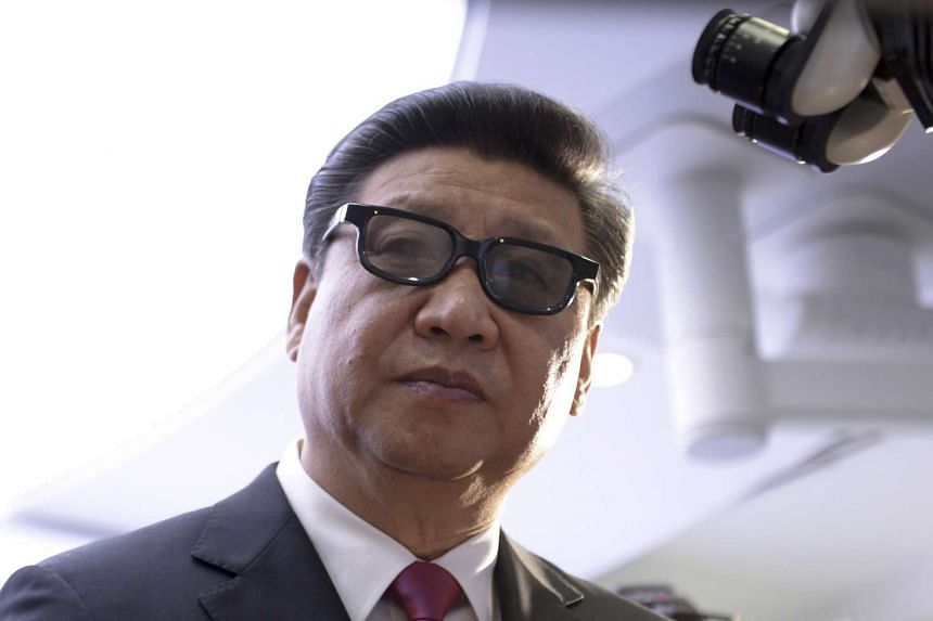 Xi wears 3D glasses to view robotic equipment at the Hamlyn Centre for Medical Robotics, during a visit to Imperial College in London.