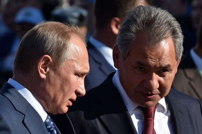 Russia's President Vladimir Putin (left) speaking with Defence Minister Sergei Shoigu at the International Aviation and Space Show, in Zhukovsky, outside Moscow, on Aug 25, 2015.