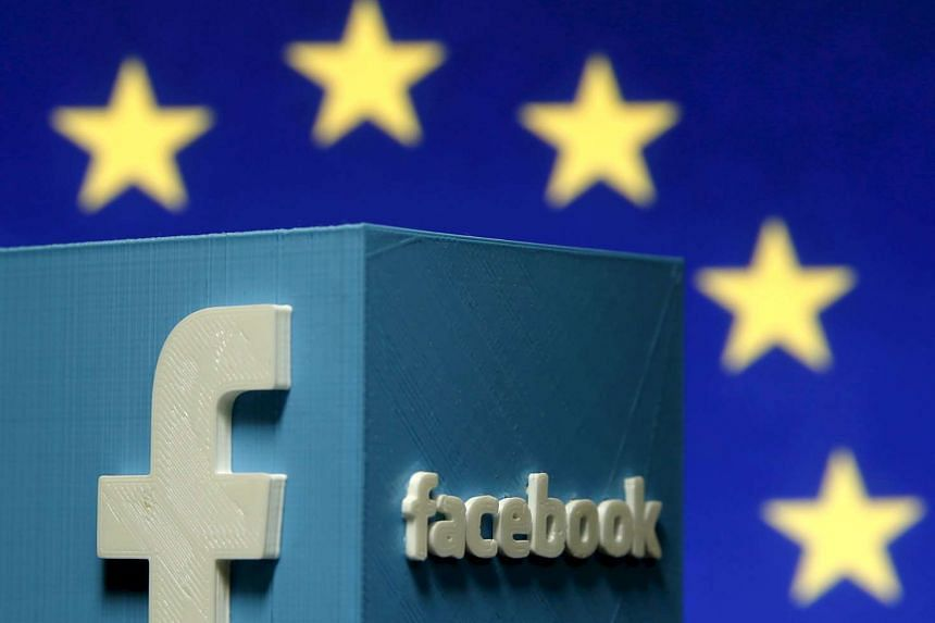 A 3D-printed Facebook logo is seen in front of the logo of the European Union in this file picture illustration made in Zenica, Bosnia and Herzegovina, May 15, 2015.