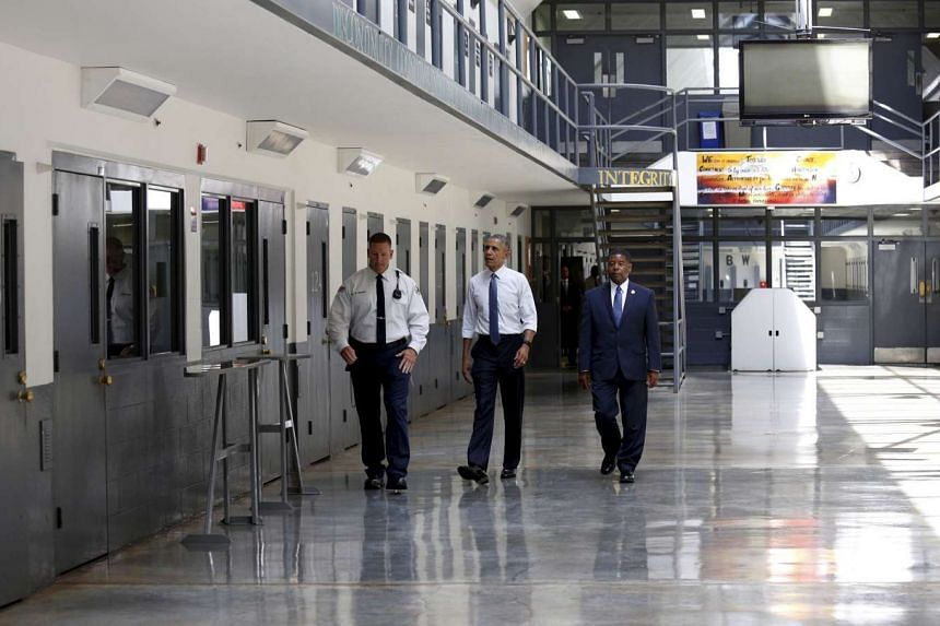 US President Barack Obama tours the El Reno Federal Correctional Institution in El Reno, Oklahoma, in this file photo taken July 16, 2015. With Obama are Bureau of Prisons Director Charles Samuels (right) and correctional officer Ronald Warwick.