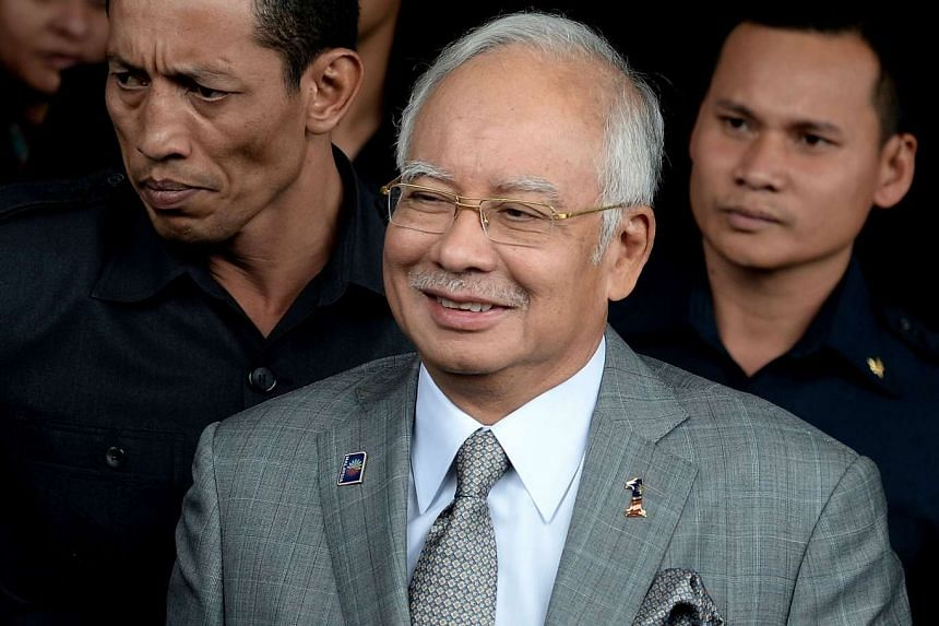 Malaysia's Prime Minister Najib Razak (centre) leaves after a parliament session in Kuala Lumpur on Oct 19, 2015.