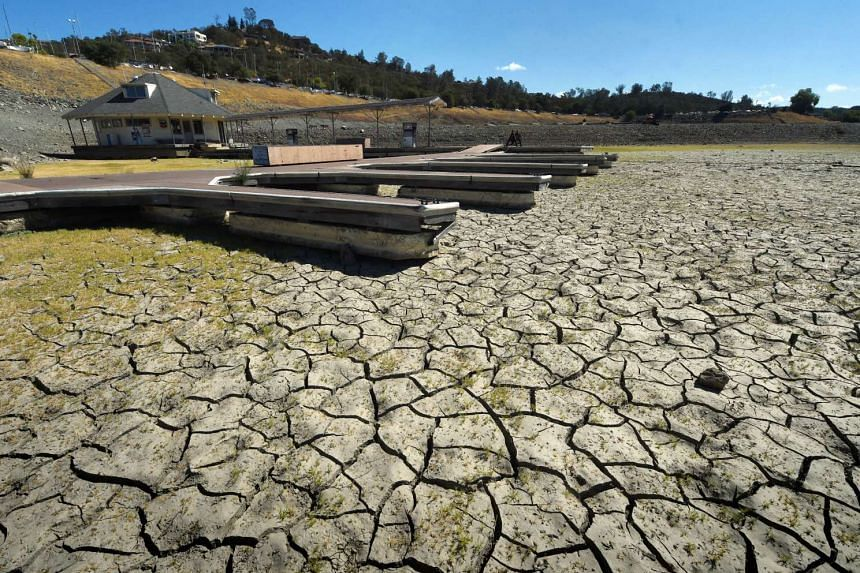 This Sept 17, 2015 file photo shows boat docks sitting empty on dry land, as Folsom Lake reservoir near Sacramento stands at only 18 per cent capacity, as the severe drought continues in California.