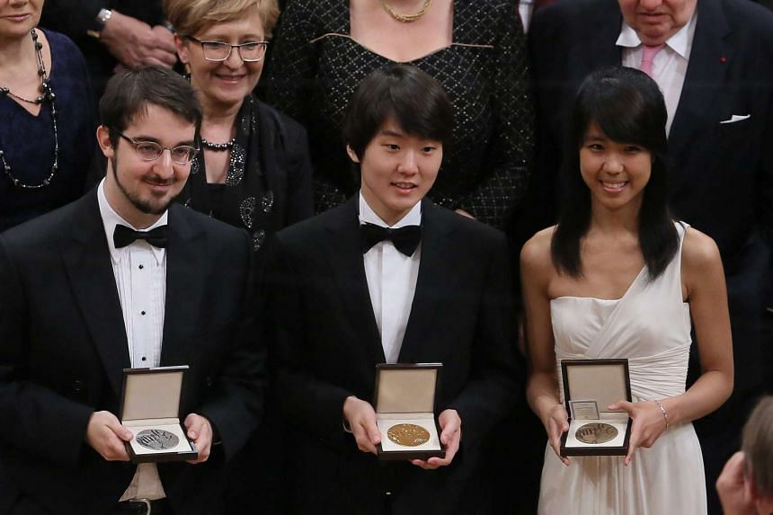 From left, silver medalist Charles Richard-Hamelin, gold medalist Seong-Jin Cho and bronze medalist Kate Liu.