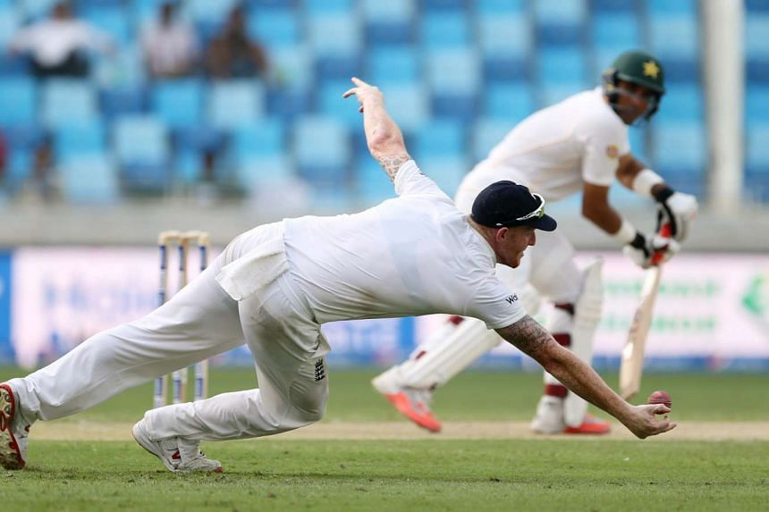 England's Ben Stokes diving to stop a shot from Pakistan's Misbal Ul-Haq.