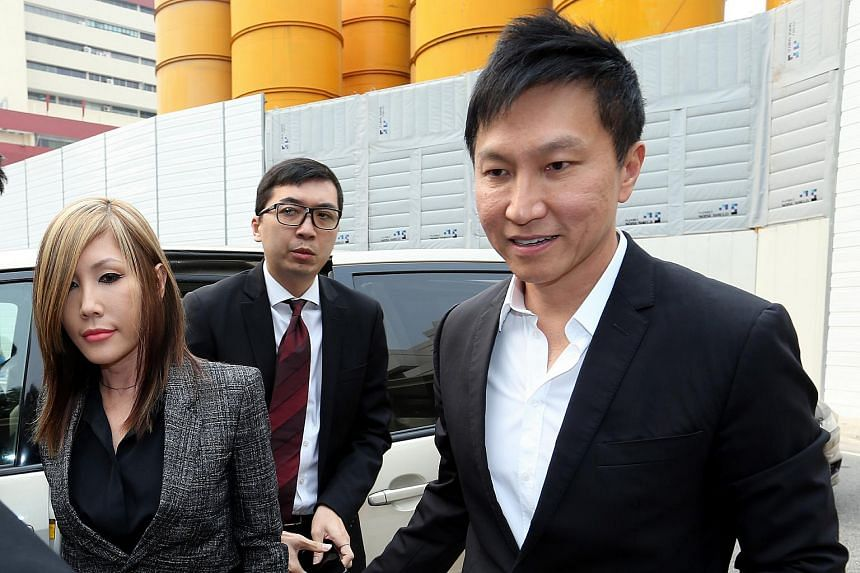 City Harvest church founder Kong Hee and his wife Ho Yeow Sun arriving at the state courts on Oct 21, 2015.