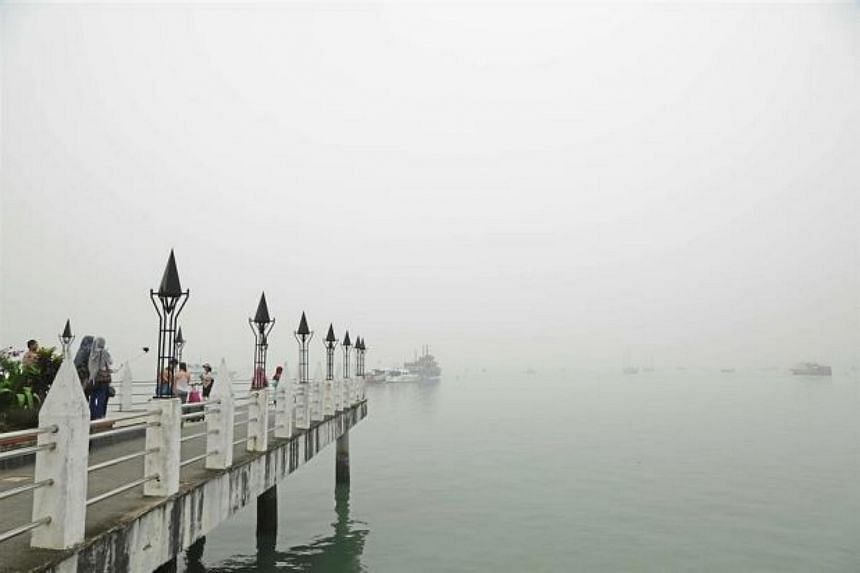 Kuah Jetty in Langkawi almost completely covered by haze.
