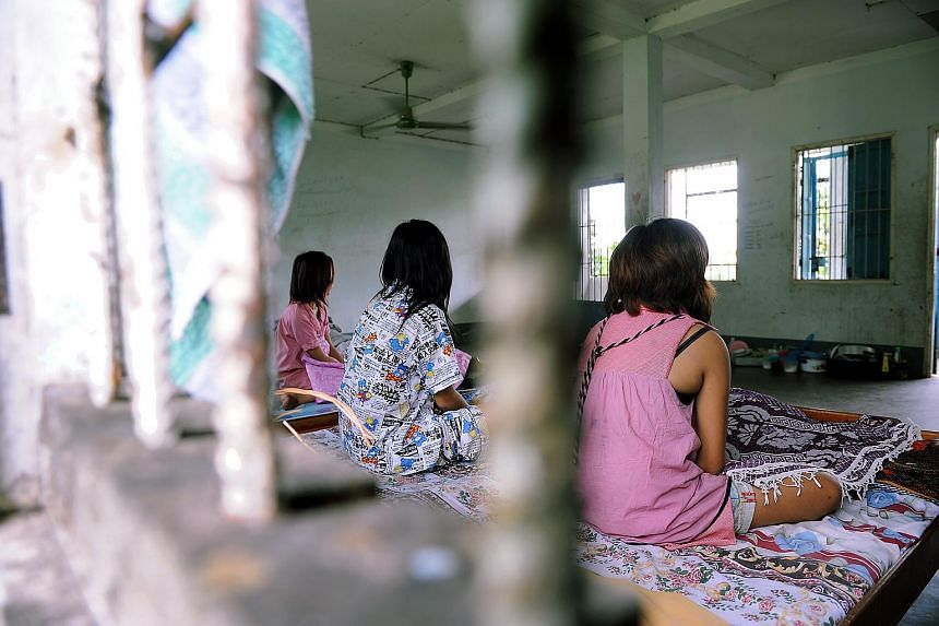 Drug addicts receiving treatment at the Vientiane Municipality Treatment and Rehabilitation Hospital in Laos in 2009.