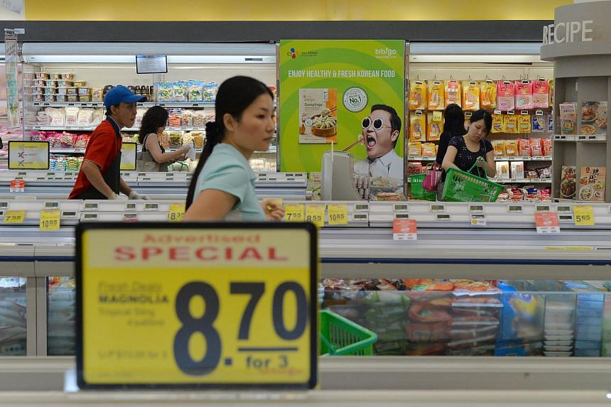 Shoppers at an NTUC FairPrice outlet at Nex mall on Oct 7, 2015.