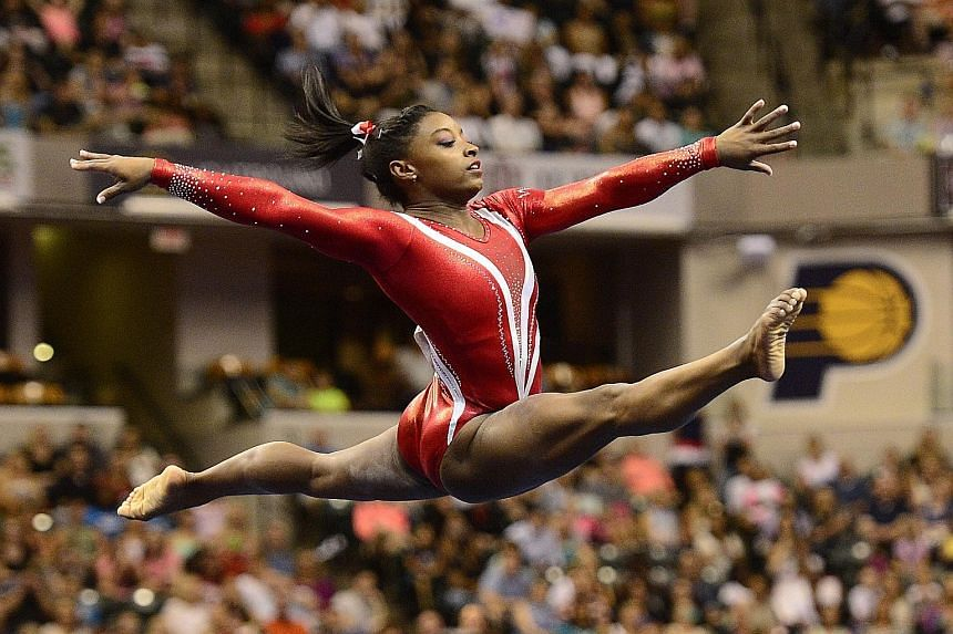 ABOVE: Simone Biles during the US national championships. She is bidding for her third straight all-around title in Glasgow. LEFT: The team gold is the only one missing from Japanese gymnast Kohei Uchimura's huge collection.